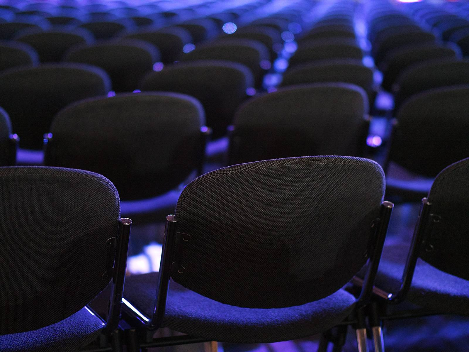Empty seats at a conference
