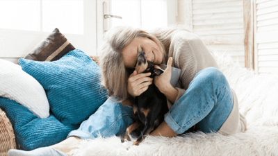 Woman cuddling with a dog