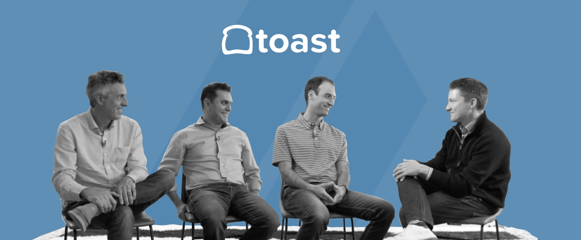 Image of 4 men sitting in chairs having a conversation. Logo of Toast in background.