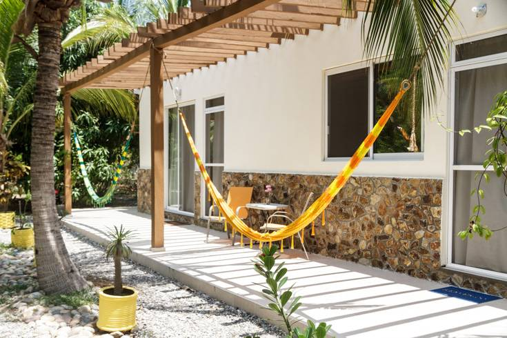 Bungalow with 3 bedrooms, terrace and hammock view.