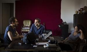 Abdalla talks with Mosireen video activists Aalam Wassef, left, and Danya Nadar, right. Photograph: David Degner David Degner/David Degner