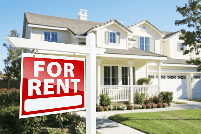 A home with a for rent sign