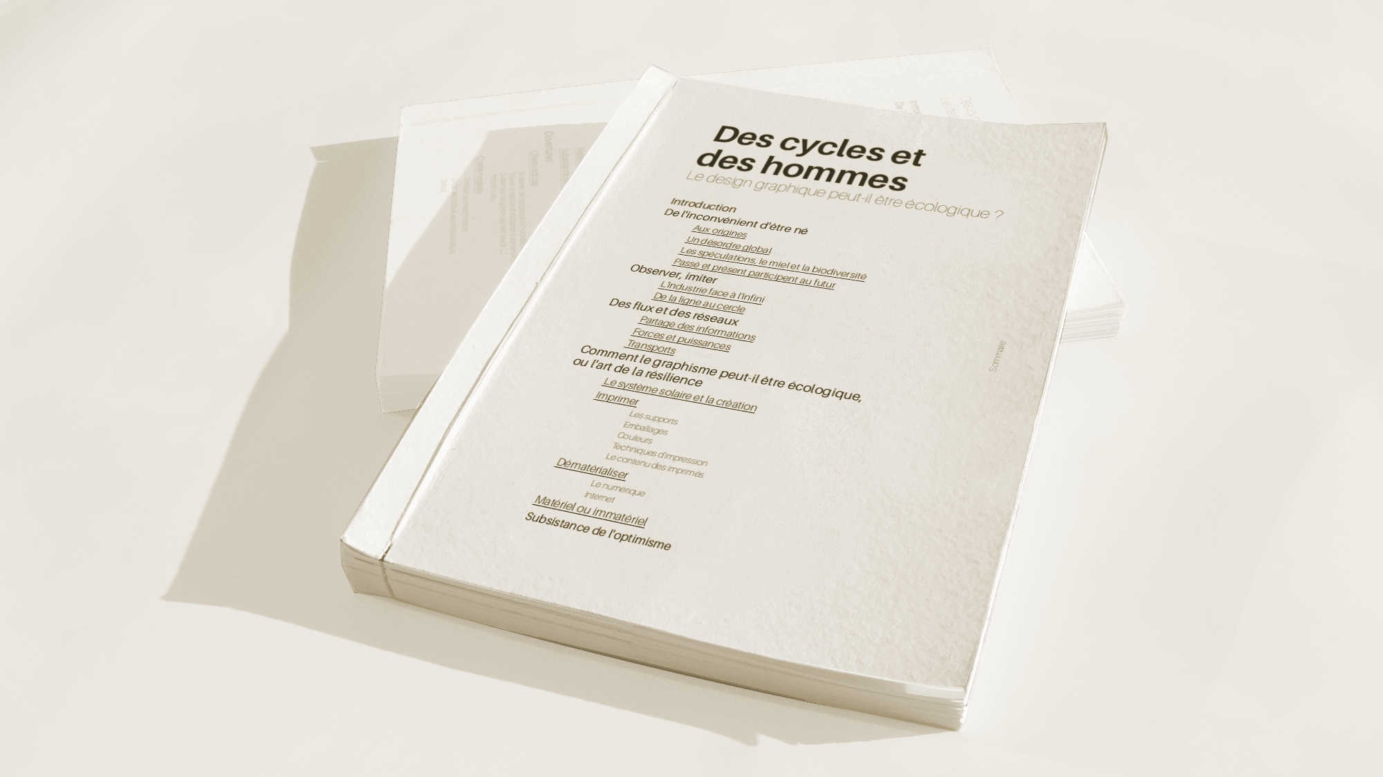 2 white copy of the essai about ethical and ecological graphic design are stacked on each other front cover visible.