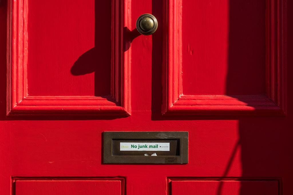Red door - Photo by Pau Casals on Unsplash