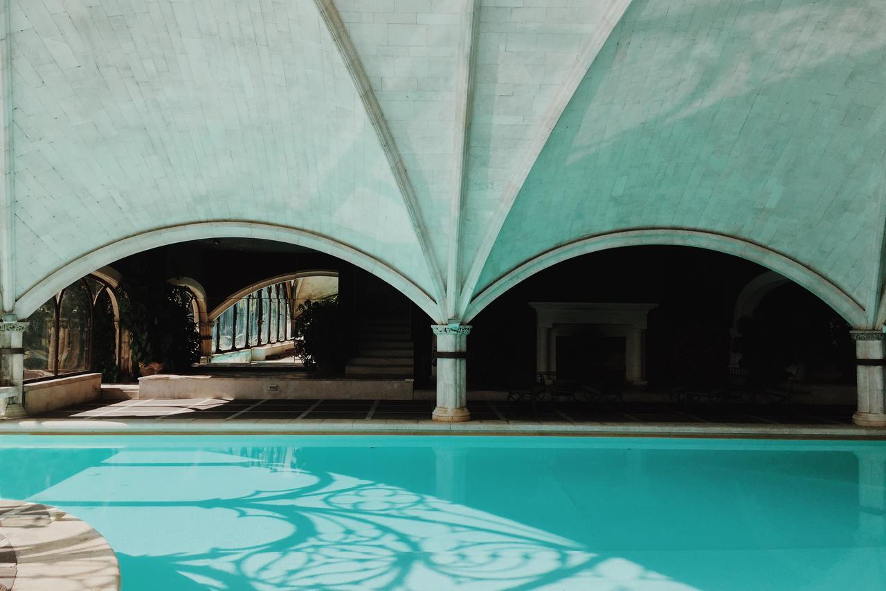 swimming pool under gothic arches at hotel landa in burgos, spain