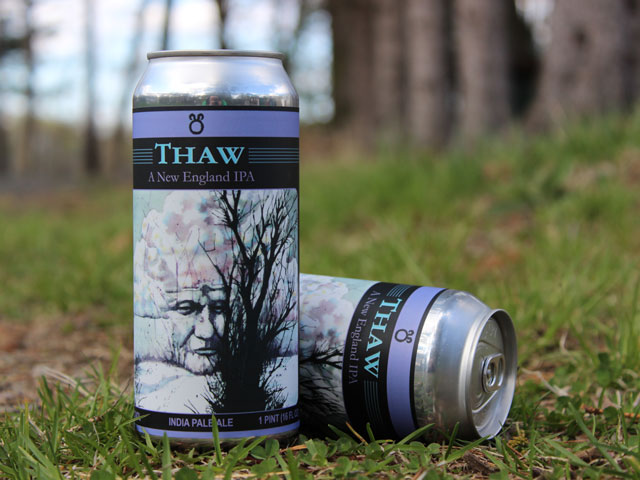 Thaw, a New England IPA brewed by Four Phantoms Brewing