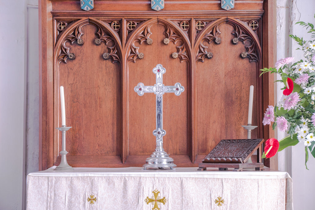 A cross displayed at the altar in a church