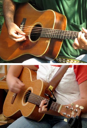 Two steel-string guitars. Top: a dreadnought guitar. Bottom: a 'parlor' guitar, with a capo in use.