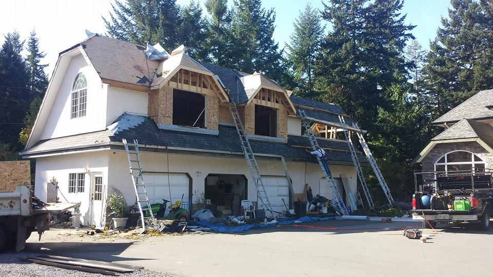 Re-roof in progress of a two story garage