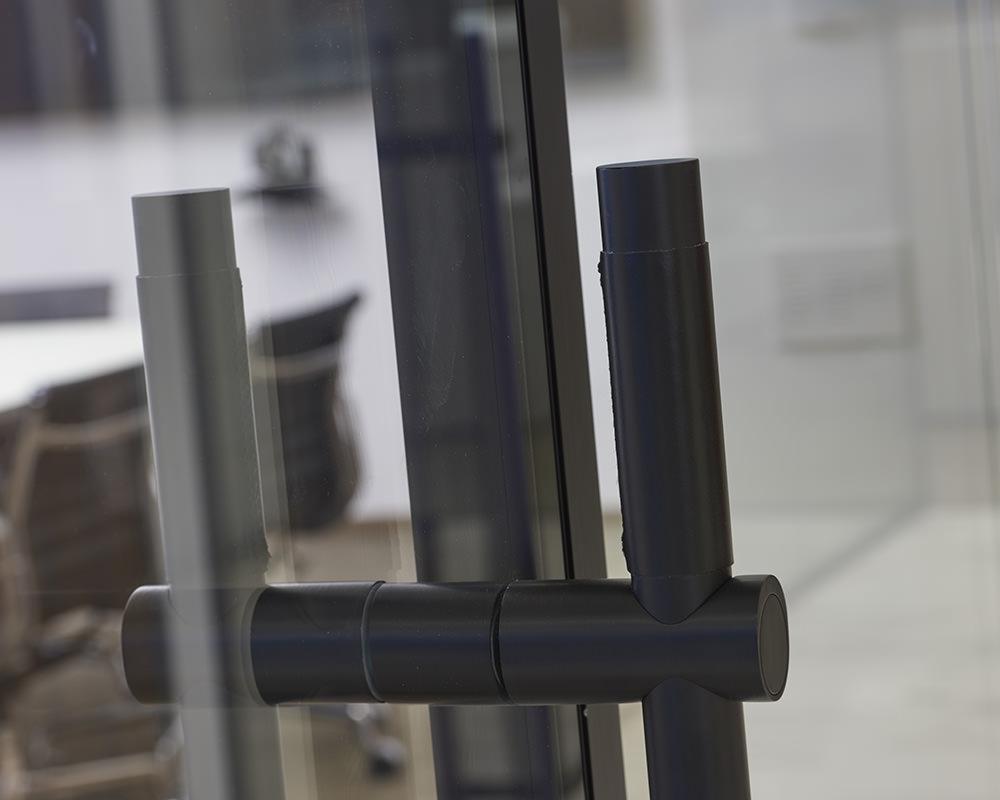 Close-up black Barn Door Handle on Glass Door