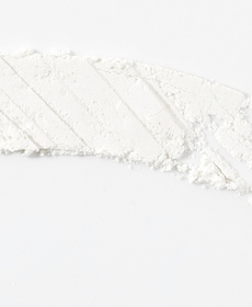 Minocycline - Light gray backdrop with a fine white powder, shaped in a rectangle across the image with stright diagnol lines cut in.