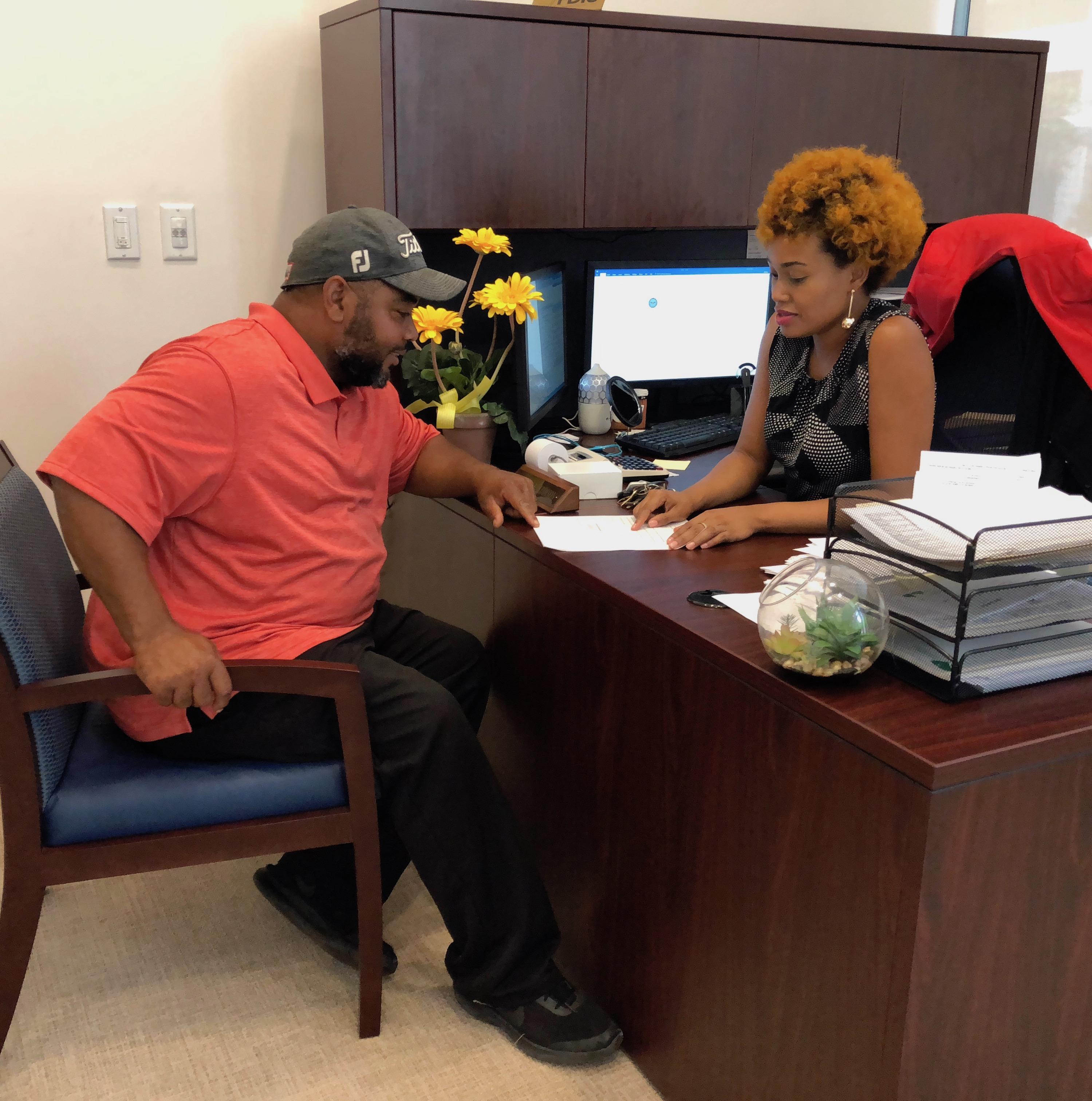 Optus Customer with Optus employee explaining loan documents