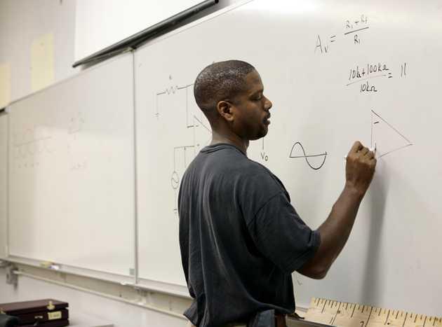 Man doing math on whiteboard
