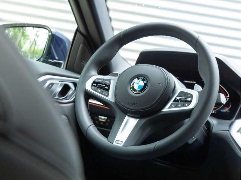 BMW 4 Serie Coupé M440i xDrive M-Sport - Head-up - Dak - Camera - DAB afbeelding 20
