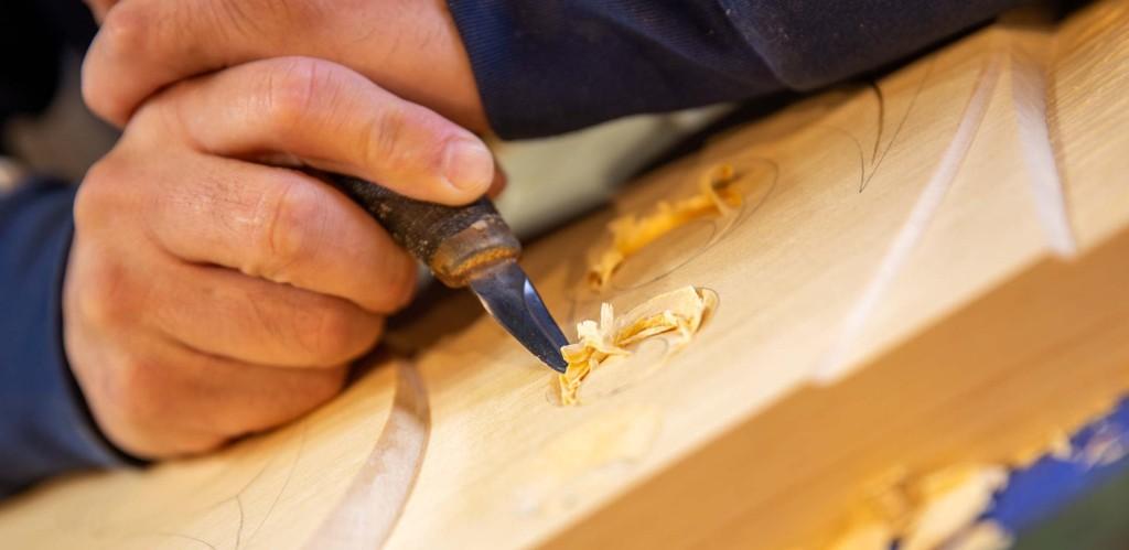 Detail of Musqueam artist Brett Sparrow carving into wood