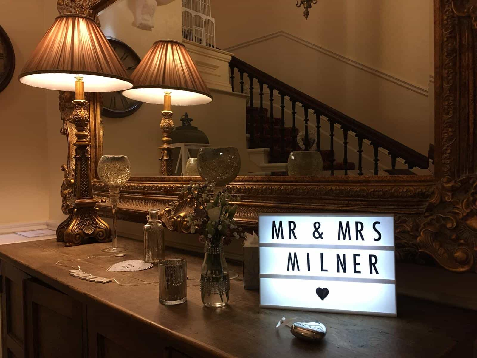 Wedding LED lights, on a table, spelling out 'Mr & Mrs Milner'