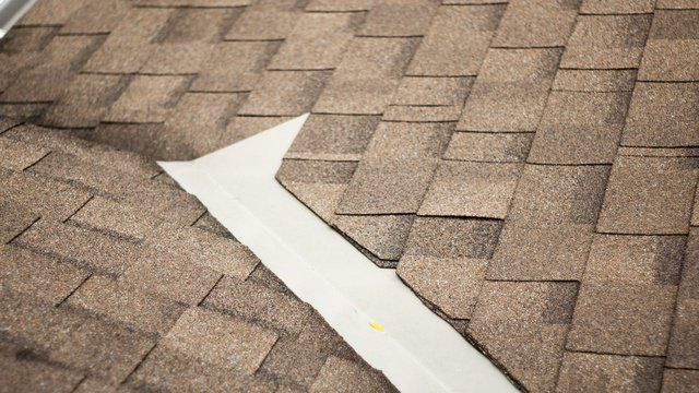 Weathered shingles and valley with flashing