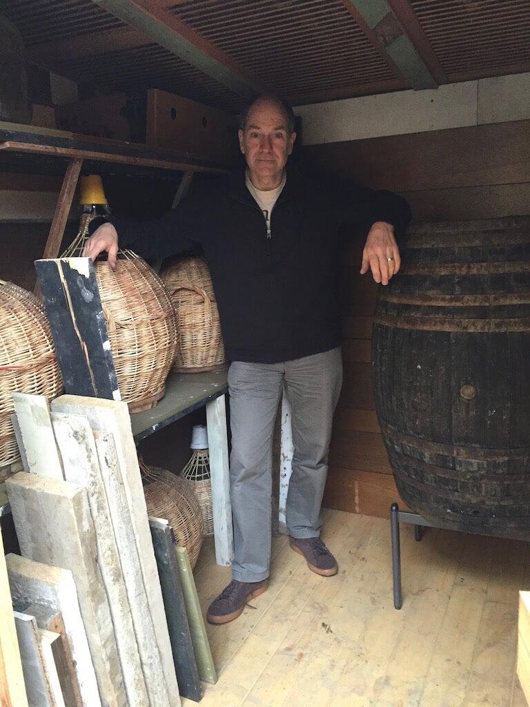 Luigi in the Baracca Sterlini with his wine making aparatus