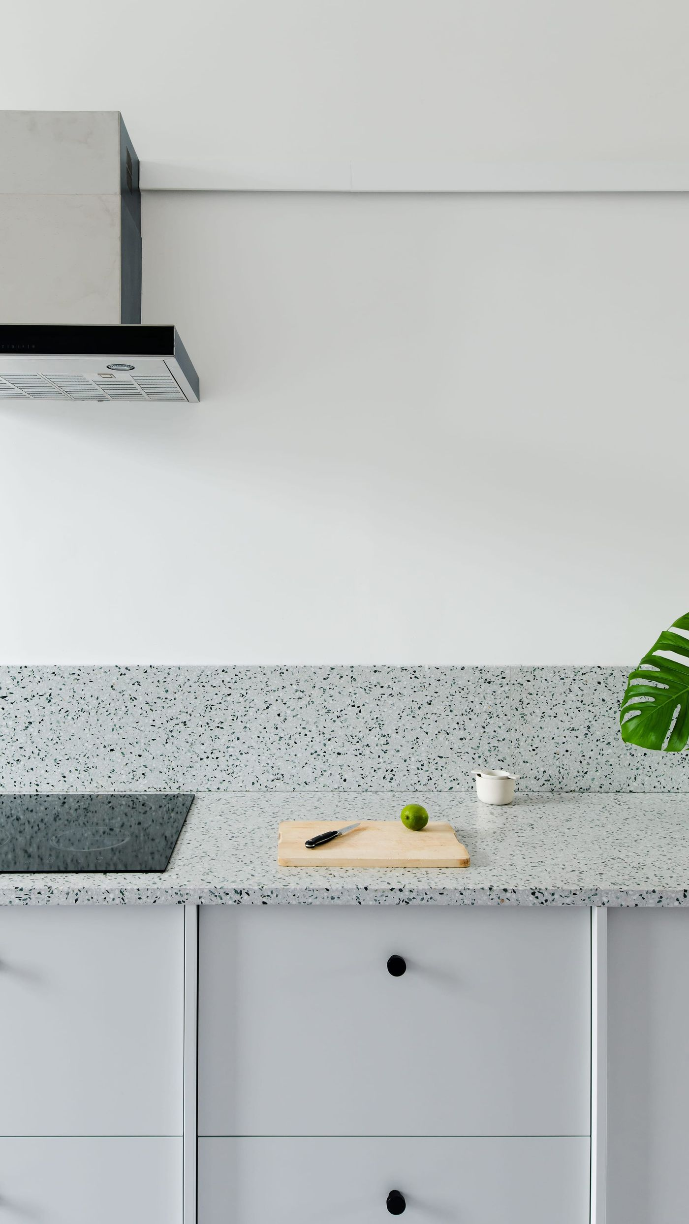 Bespoke kitchen kitchen details of light grey cabinets and terrazzo worktop in Kelham Island, Sheffield designed by From Works.