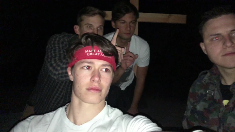 Ryan Sanchez (right) and Christian Secor (furthest back) along with two other unidentified Groypers pose with the wooden cross they raised in place of the Atascadero monolith