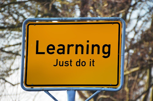 Tutoring image of a sign that says Learning Just do it