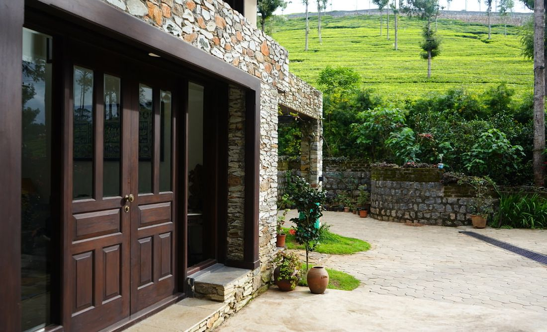 Door to living with tea estate background