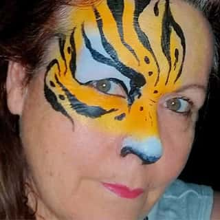 A tiger design painted on a woman's face. Click to view at full size.