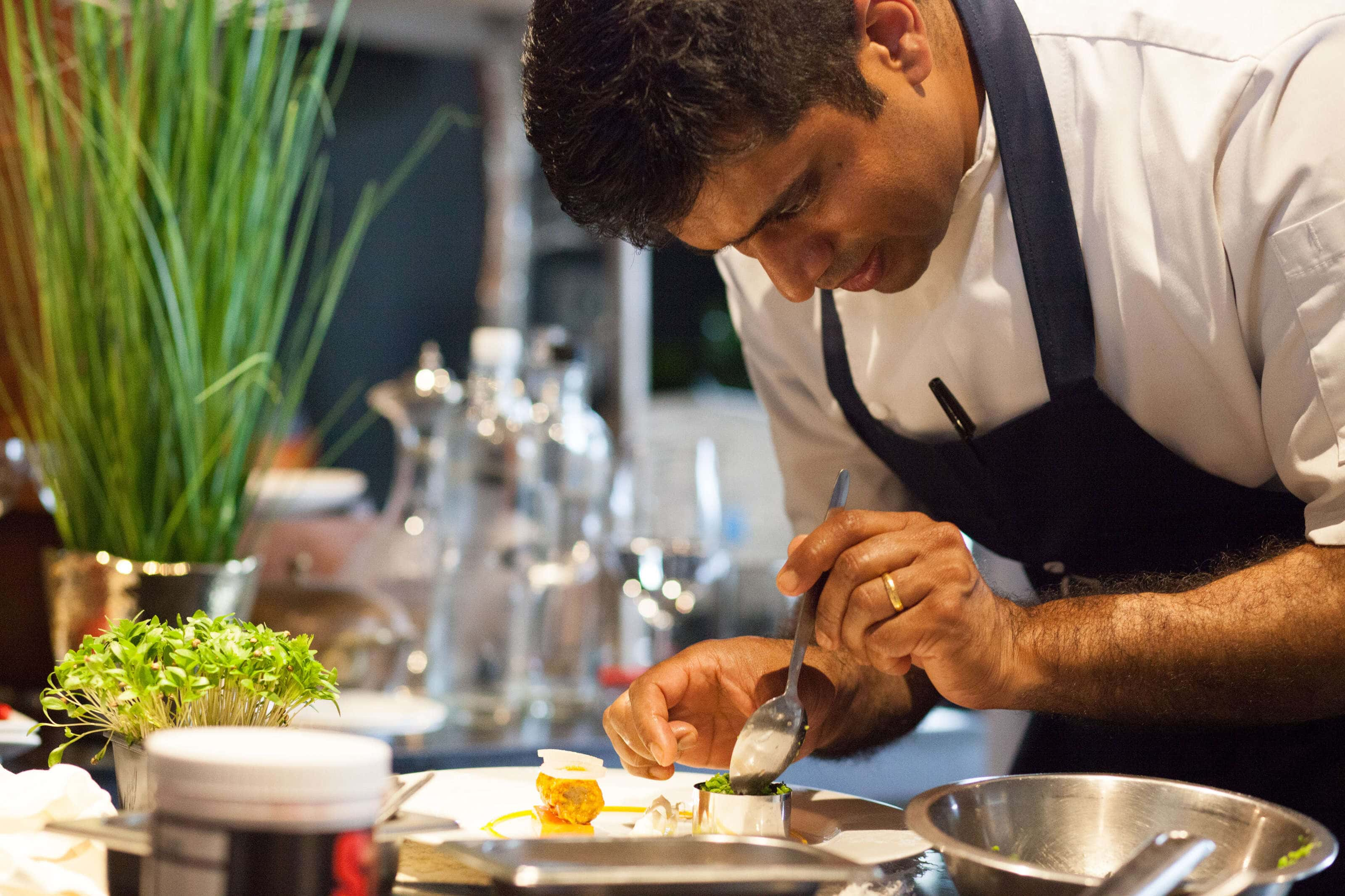 Hrishikesh Desai prepping a dish for a food photography shoot at the Gilpin Lakehouse in Cumbria.