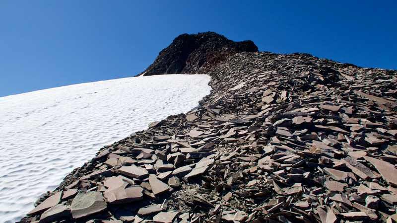 Steep climb over loose talus on Old Snowy