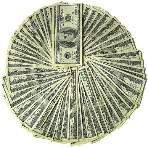 100 dollar bills fanned out in a circle
