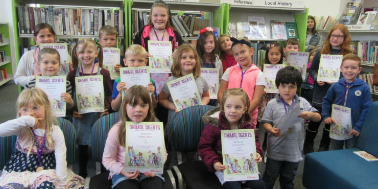 Children with their Summer Reading Challenge certificates and medals at Brandon Library