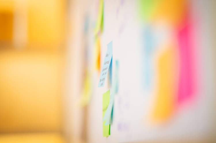 An image of sticky notes during a brainstorming session for digital ads