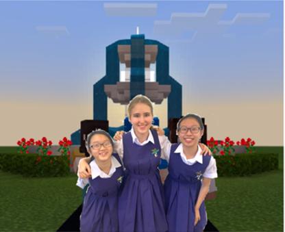 Photograph of Team Futurae members: (L to R) Hilary Chee, Anastasiya Samushkova, Zhang Haiyun in front of a Minecraft background