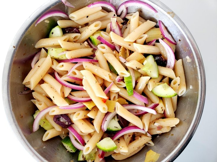 Bowl full of greek pasta salad