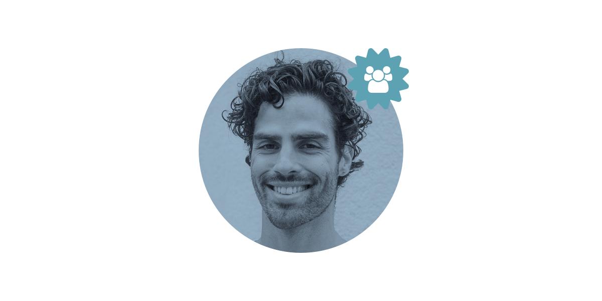 A UX design graduate smiling at the camera