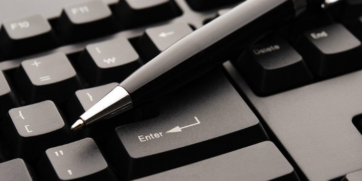 A pen on a computer keyboard