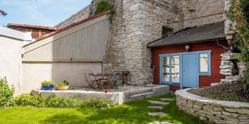 A 538 square foot cottage in Sweden, built into medieval walls.