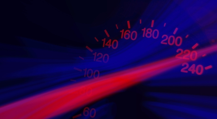 A car speedo with light gleam