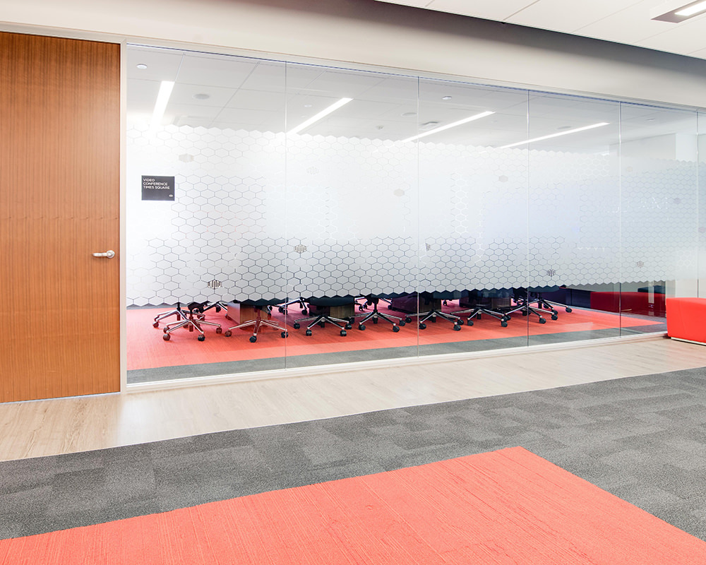 Long Glass Wall with Decorative Film Pattern