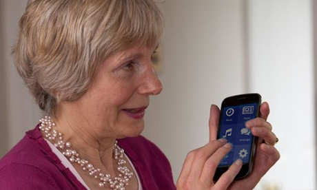 A blind woman touching a smartphone display