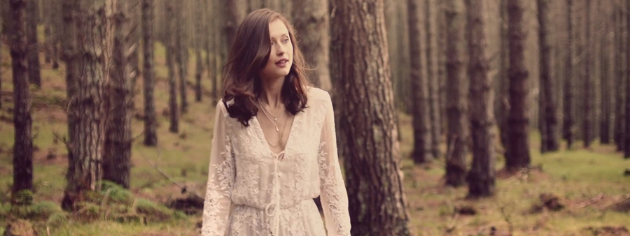 Ecoya campaign still of woman in forrest