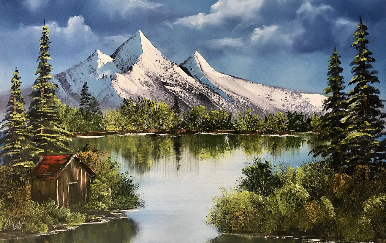 Bob Ross painting of distant mountains with a lake and cabin in the foreground
