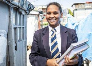 Schoolgirl carrying textbooks