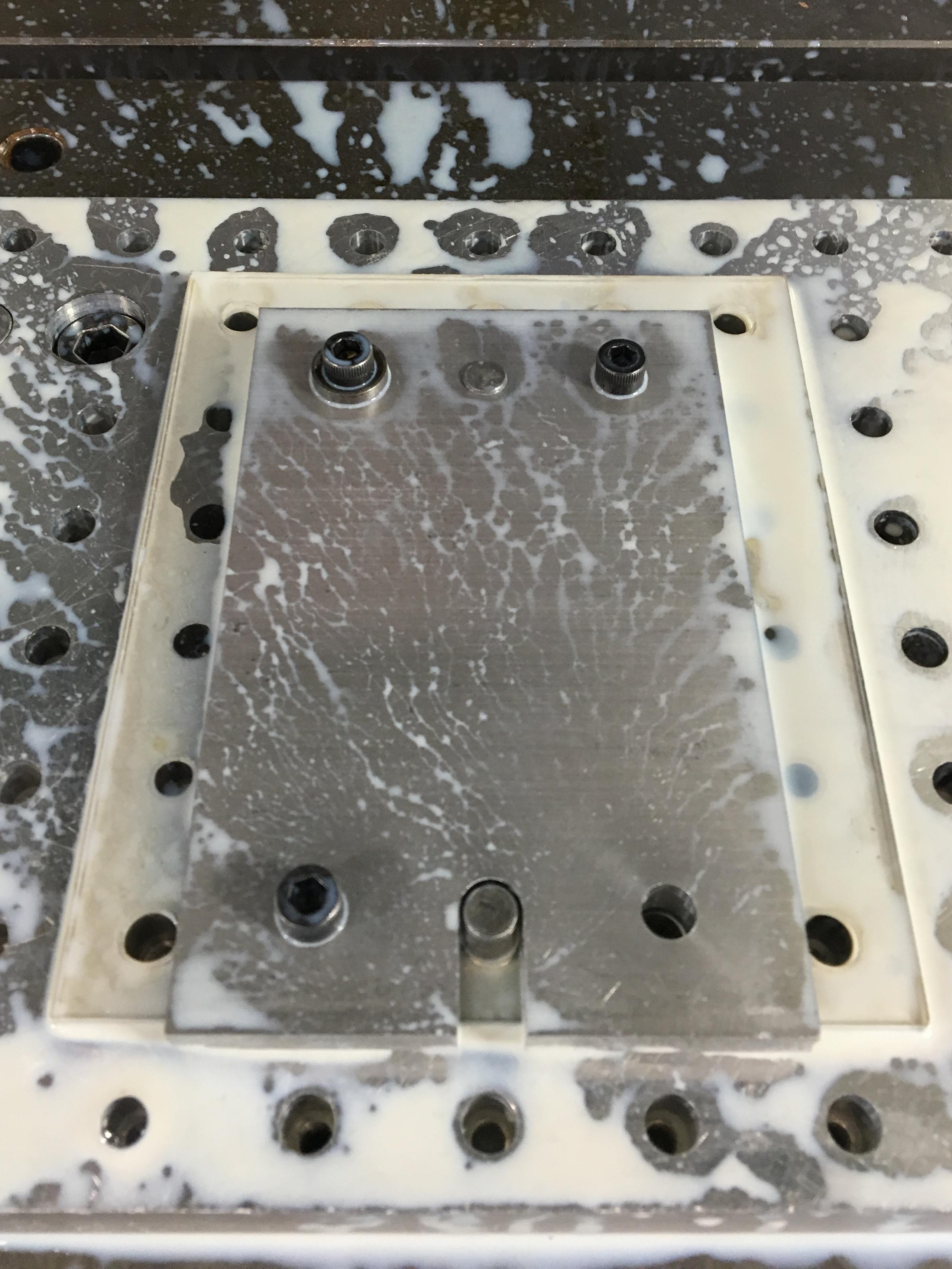 Aluminum stock fixtured within CNC