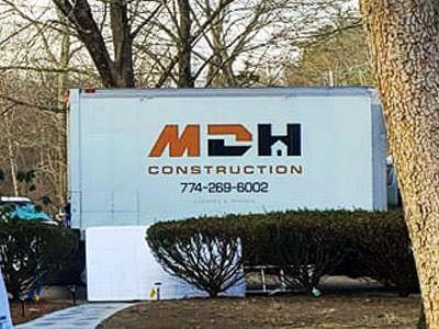 MDH Construction truck close up during a home improvement project in Plymouth, MA
