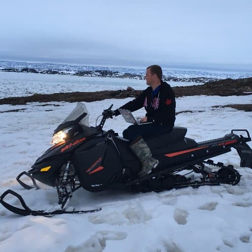 Mike Rogers on a Snowmobile