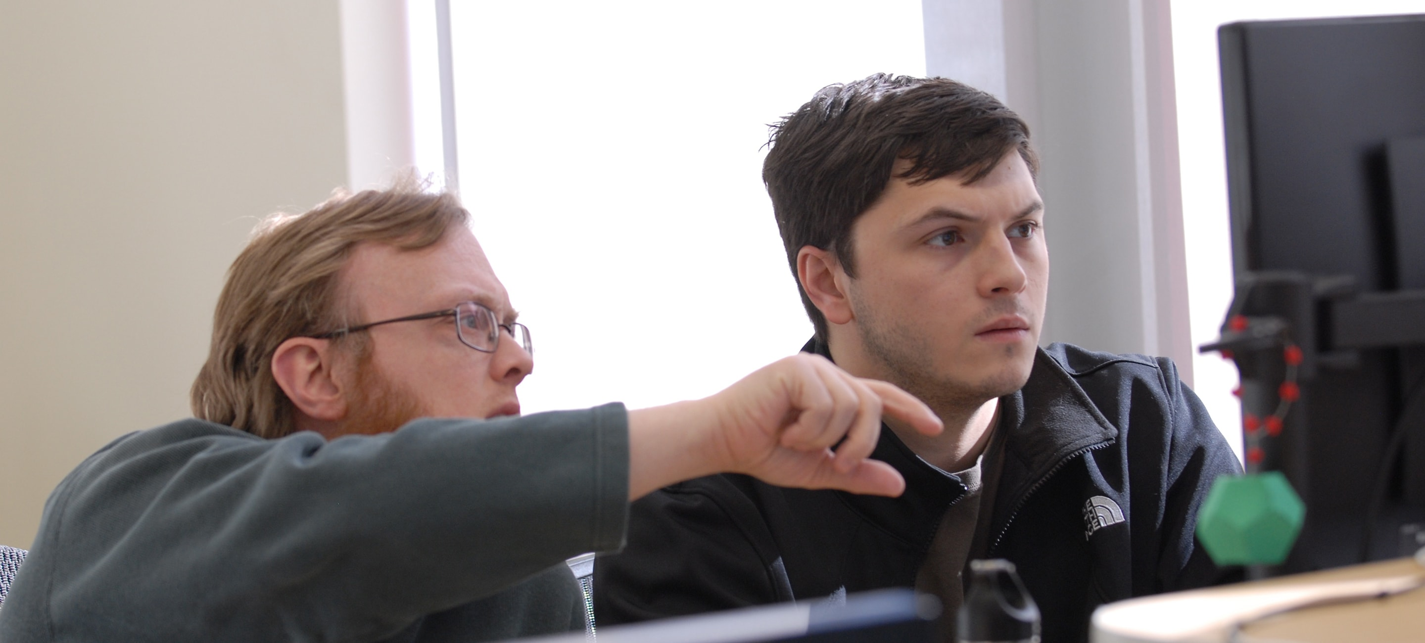 Engineers discussing implementation