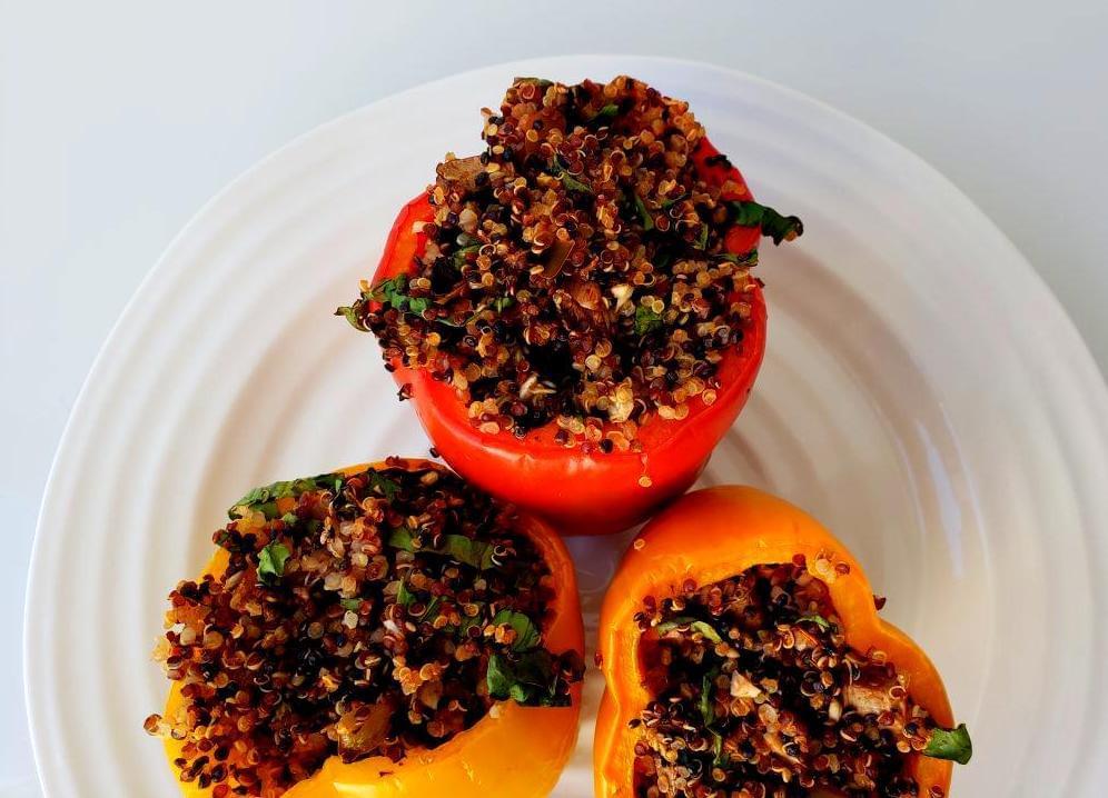 Plate of three quinoa and mushroom stuffed peppers