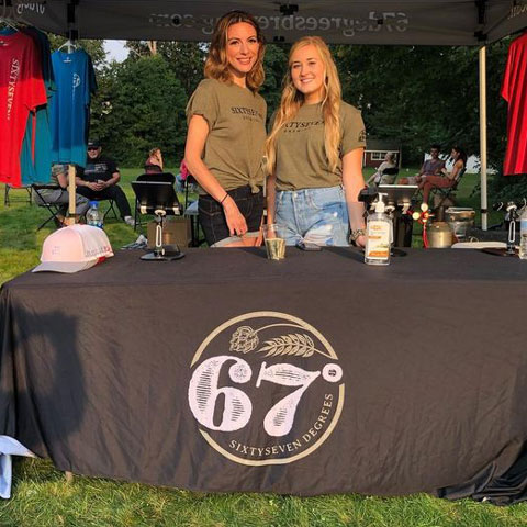 67 Degrees Brewing Staff working a beer & merch table