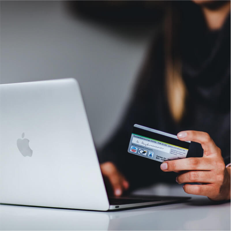 Customer making an online purchase with debit card